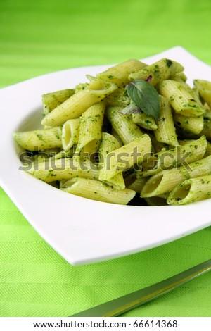 Pasta with Italian pesto sauce with basil - stock photo