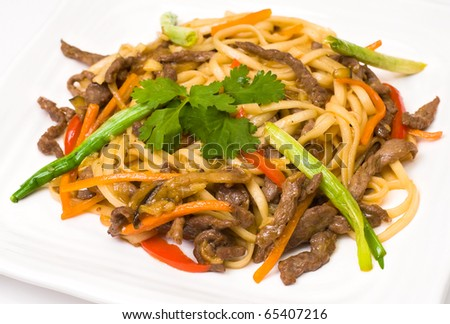 pasta with meat and vegetables, seasoned with tomato sauce