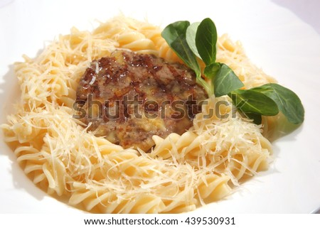 pasta with meat Patty and cheese - stock photo