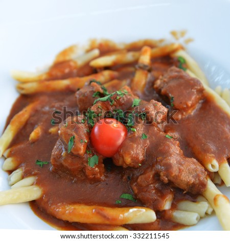 Pasta with meat, tomato sauce on dish - stock photo