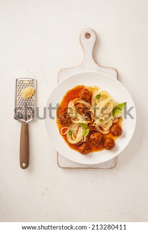 Pasta with meatballs and basil with tomato sauce