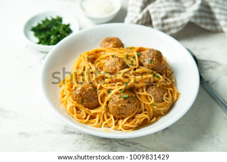 Pasta with meatballs, fresh parsley and Parmesan cheese