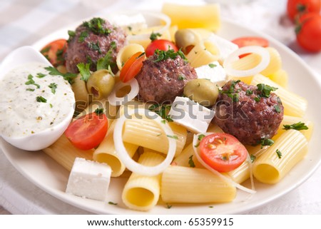 Pasta with meatballs,tomato and green olives