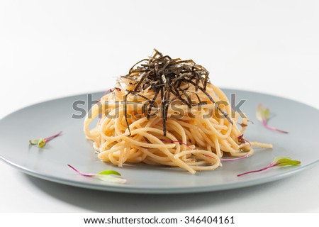 Pasta with Mentaiko (Cod fish's roe) sauce, Japanese food in European style - stock photo