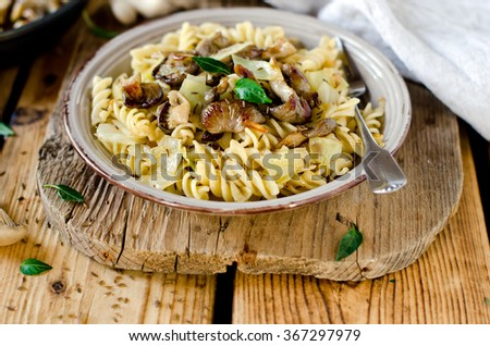 Pasta with mushrooms, cabbage and caraway seeds - stock photo