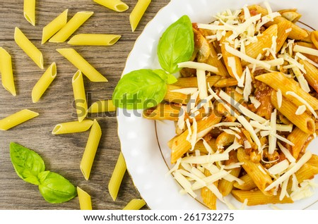 Pasta with mushrooms, minced meat, tomatoes and cheese