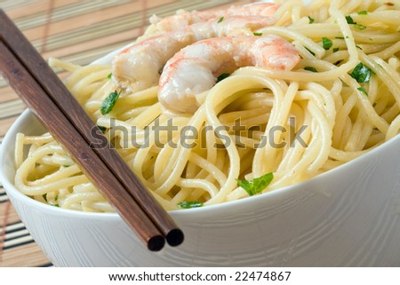 pasta with parsley and prawn on white bowl whit chopstick - stock photo