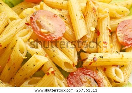 Pasta with pasta sauce and tomato - stock photo