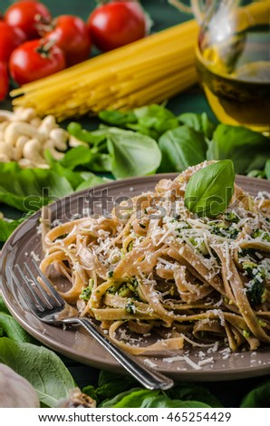 Pasta with pesto, ingredience around meal, simple and delicious italian meal