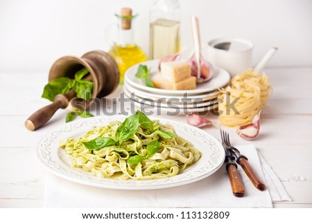 Pasta with pesto on white plate