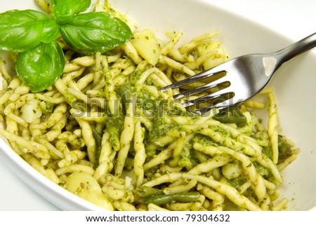 pasta with pesto on white plate - stock photo