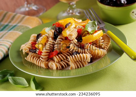 pasta with roasted peppers and black olives - stock photo