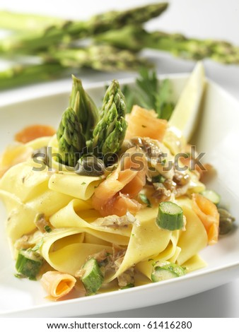 Pasta with salmon and asparagus - stock photo