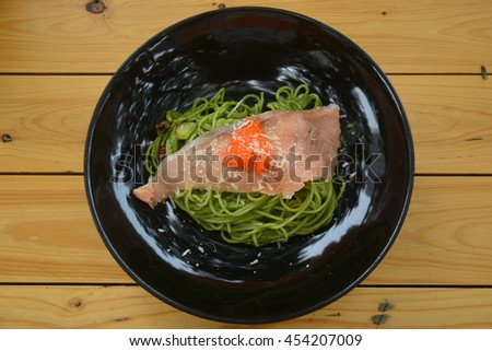 Pasta with salmon and cheese served with shrimp egg - stock photo