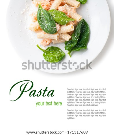 Pasta with salmon and spinach, portion of rigatoni with seafood and parmesan cheese, Italian food, isolated on white background - stock photo