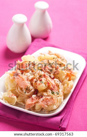 Pasta with salmon fish - stock photo