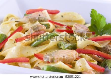 pasta with salmon in white bowl - stock photo