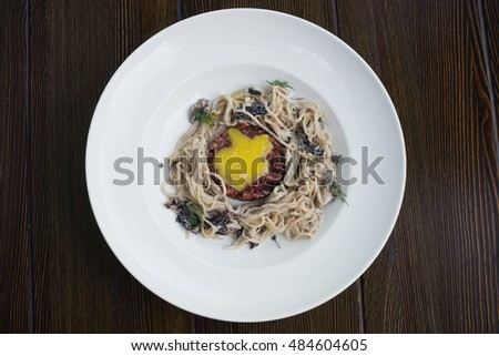 pasta with sauce and rosemary