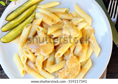 Pasta with sauce chicken and pickled cucumber