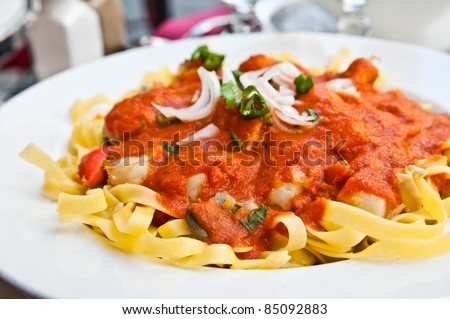 Pasta with Scallops Dinner Dish on a the table - stock photo
