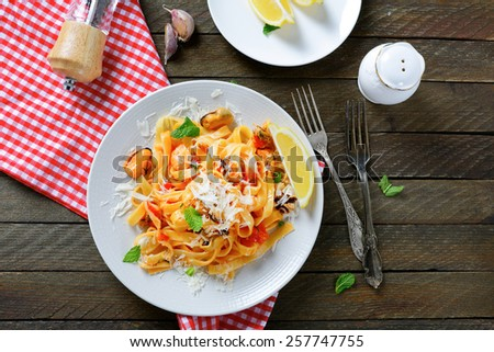 Pasta with seafood and cheese, top view - stock photo