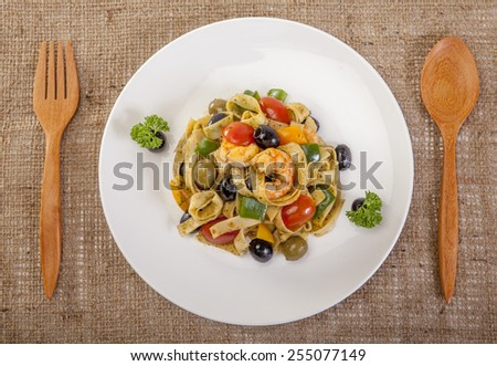 pasta with shrimps, black olives  top corner - stock photo