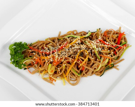 Pasta with sliced vegetables with sesame seeds and herbs - stock photo