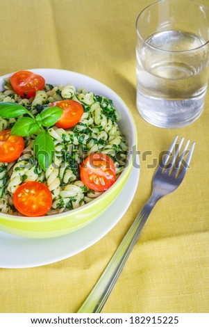 pasta with spinach and cherry tomatoes.