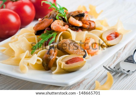 Pasta with tomato and seafood, mussels and shrimp