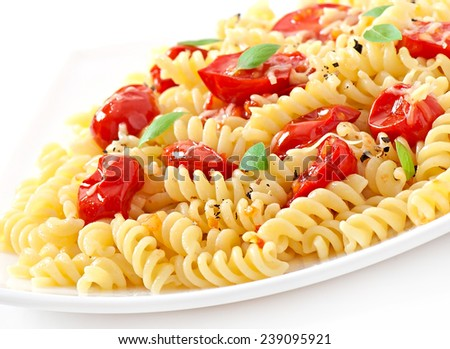 Pasta with tomato, basil and grated cheese - stock photo