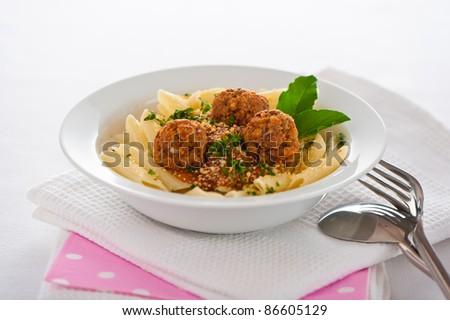 Pasta with tomato garlic sauce and meatballs - stock photo