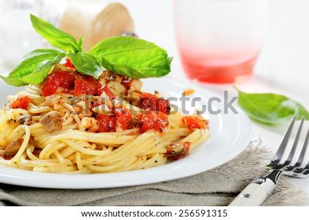 Pasta with tomato sauce and basil, food. Italian food - stock photo