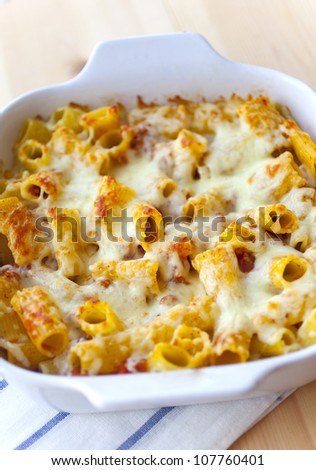Pasta with tomato sauce and cheese - stock photo