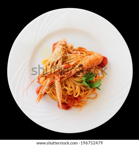 Pasta with tomato sauce and langoustines (scampi) isolated on black - stock photo