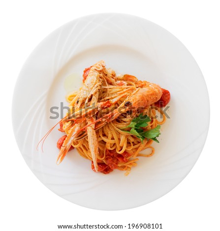 Pasta with tomato sauce and langoustines (scampi) isolated on white - stock photo