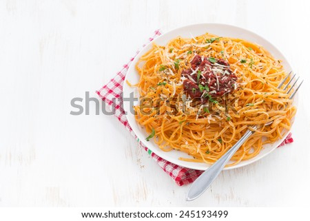 pasta with tomato sauce and parmesan on white wooden background, horizontal, top view - stock photo