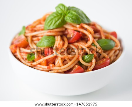 Pasta with tomato sauce and tomatoes - stock photo