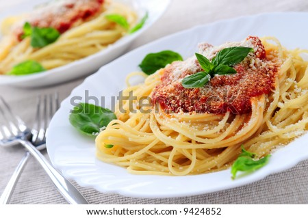 Pasta with tomato sauce basil and grated parmesan - stock photo