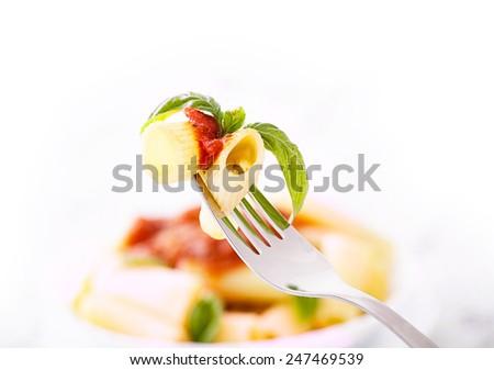 Pasta with tomato sauce. Italian cooking. - stock photo