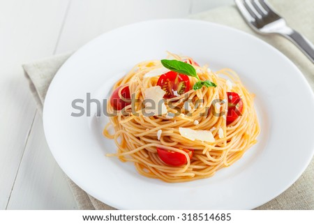 Pasta with tomato sauce, parmesan cheese and basil, Italian food