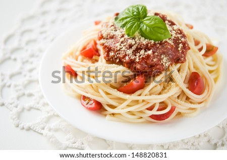 Pasta with tomato sauce, tomatoes and cheese - stock photo