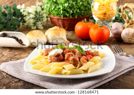 Pasta with tomato, sausage and ricotta on complex background - stock photo