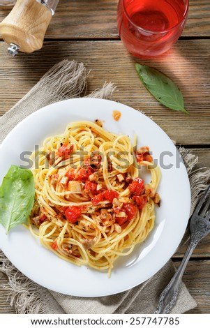 Pasta with tomato slices and mushrooms. Top view - stock photo
