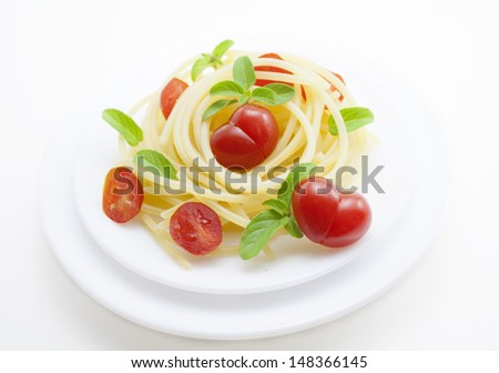 Pasta with tomatoes and basil.