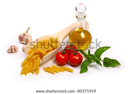 Pasta with tomatoes, olive oil and basil - stock photo