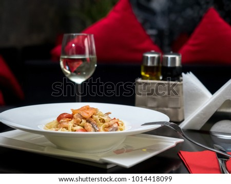 Pasta with tomatoes on a white plate