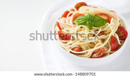 Pasta with tomatoes with cop space