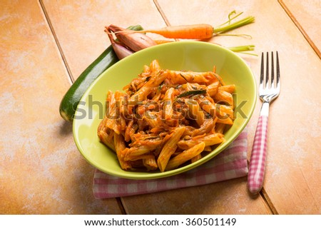 pasta with tomatoes zucchinis carrots and shallot - stock photo