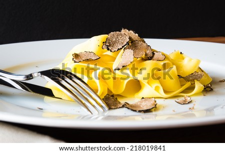 Pasta with truffles, typical autumn dish.Restaurant menu dish. - stock photo