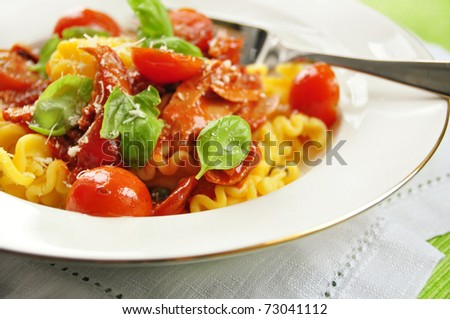 pasta with tuna fish and tomato - stock photo